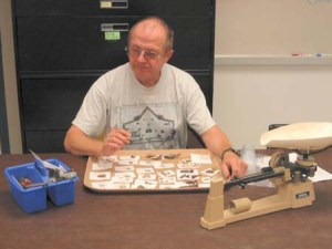 PAS member sorting artifacts at the archaeology laboratory at the University of West Florida.
